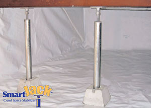 Crawl space structural support jacks installed in Bourget