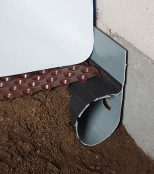 Closeup of a crawl space drainage system installed in Sarsfield