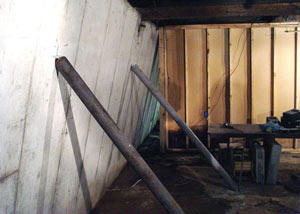 A severely tilting foundation wall propped up by steel beams in Crysler.