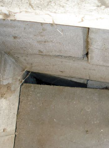 inward rotation of a foundation wall damaged by street creep in a garage in Maxville