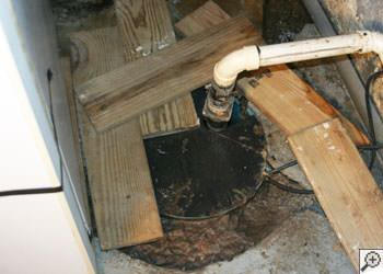 An ugly, clogged sump pump system in Smiths Falls, Ontario