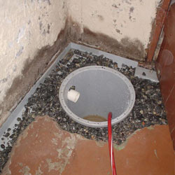 Installing a sump in a sump pump liner in a Orleans home