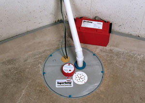A sump pump system with a battery backup system installed in Embrun