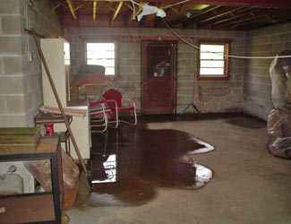 a flooded basement floor in a Edwards home