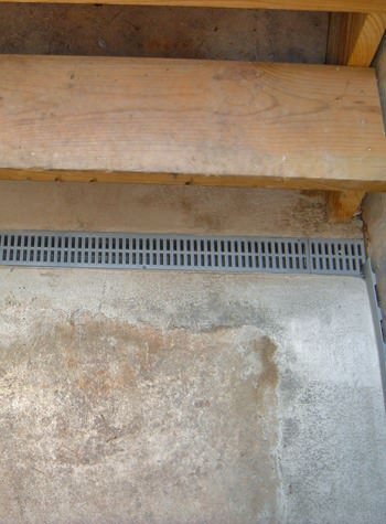grated basement drain weeping tile system for use with flooded