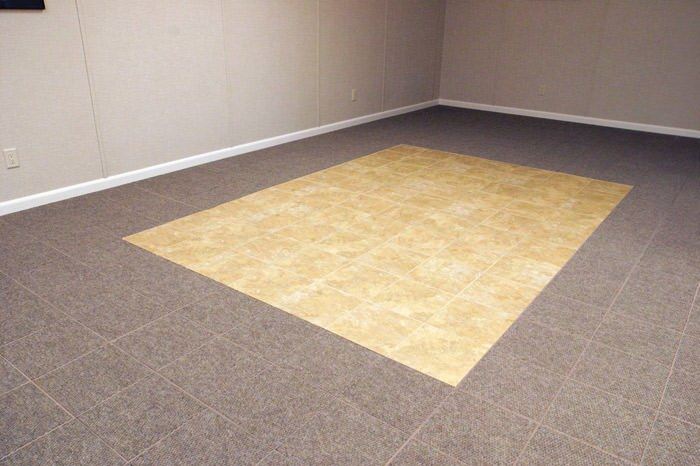 tiled and carpeted basement flooring installed in a Gloucester home