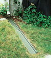 A recessed gutter drain extension installed in Edwards, Ontario